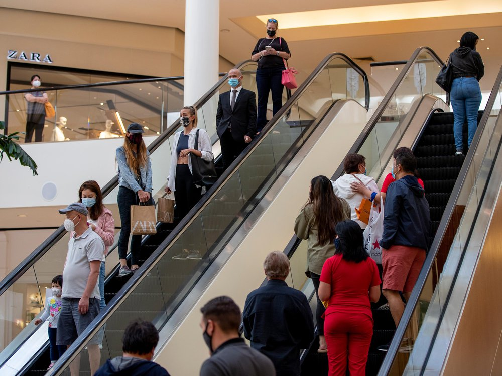 Shoppers continue to wear masks inside South Coast Plaza on May 13, 2021 in Costa Mesa, California.