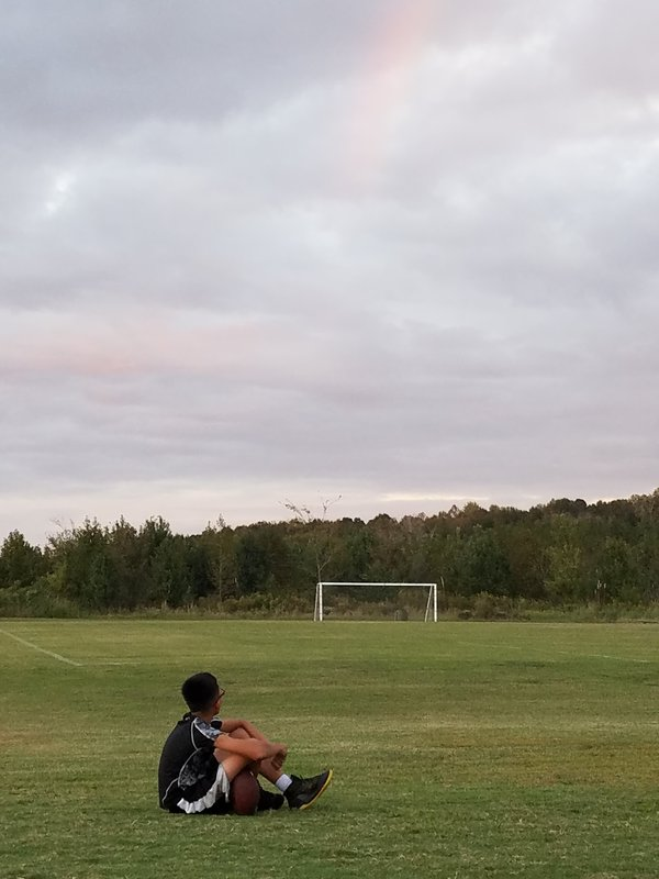Son resting on the soccer field.  thumbnail