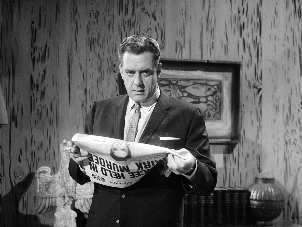 the character Perry Mason holding a newspaper and looking thoughtful