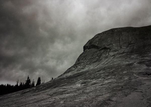 A storm brewing over a mountaintop thumbnail