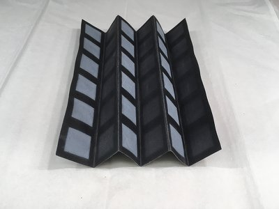 The structure of the battery is formed from a sheet of chromatography paper, divided into a grid of creases.