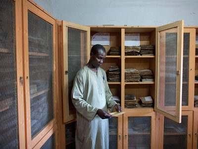 Librarian Aboubakar Yaro examines an Islamic manuscript from the 17th century at the Djenne Library of Manuscipts, in Djenne, Mali, September 2012. Djenne is thought to have at least 10,000 manuscripts held in private collections, dating from the 14th to 20th centuries.