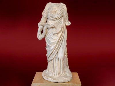 A different headless statue of health goddess Hygieia