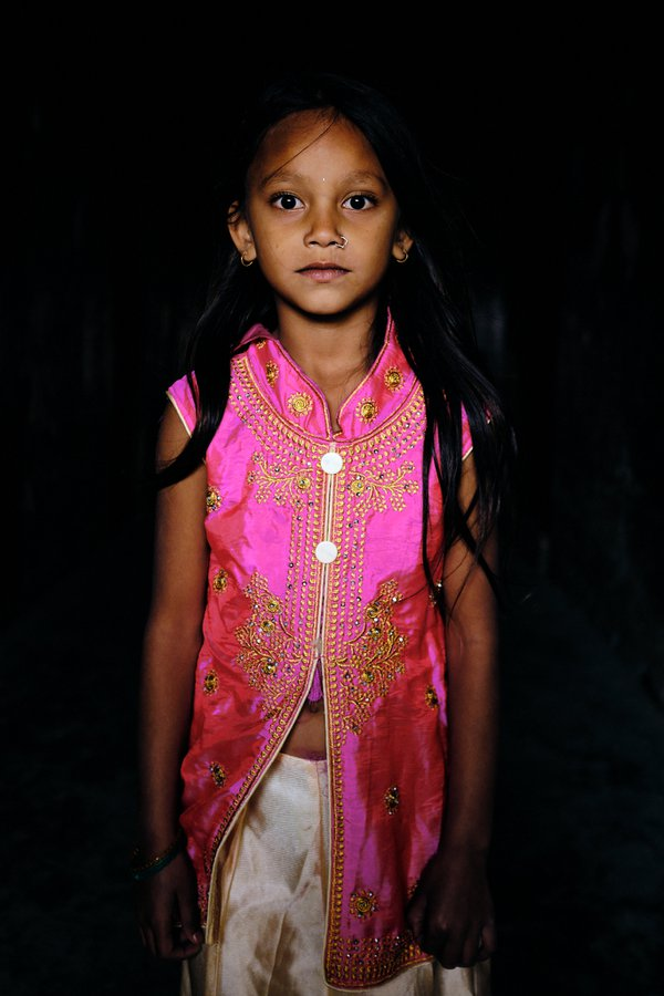 Young Nepali girl poses for a picture in her festive clothes thumbnail