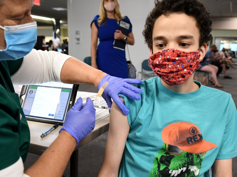 A nurse gives a 16-year-old a shot of the vaccine at a clinic in Florida.
