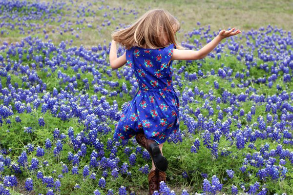 Dancing with Joy in a field of wild bluebonnets thumbnail