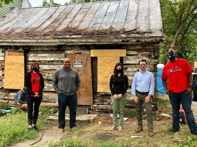 Archaeologists pose in front of the 180-year-old cabin in Hagerstown, Maryland.