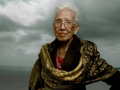 """Posed in Hampton, Virginia, Katherine Johnson stands before a backdrop of gathering clouds, """"symbolic of the obstacles ... that she had to face in her career,"""" says curator William Pretzer."""