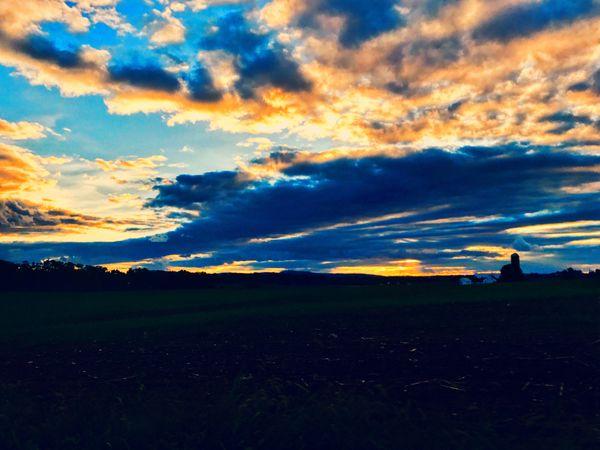 Sunset over a farm thumbnail
