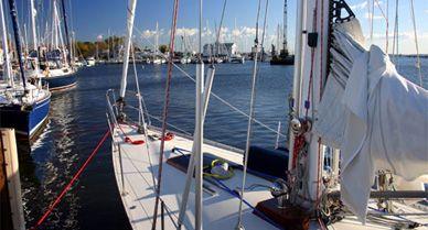 A sailboat floats at the dock