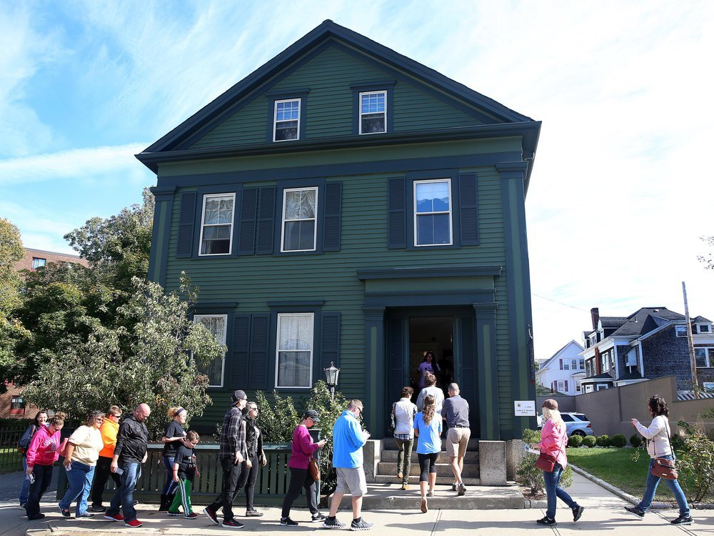 Tourists walk into the Lizzie Borden House