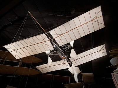 In 1891, Samuel P. Langley began experiments with large, tandem-winged models powered by small steam and gasoline engines that he called aerodromes. After several failures with designs that were too fragile and under-powered to sustain themselves, Langley had his first genuine success on May 6, 1896.