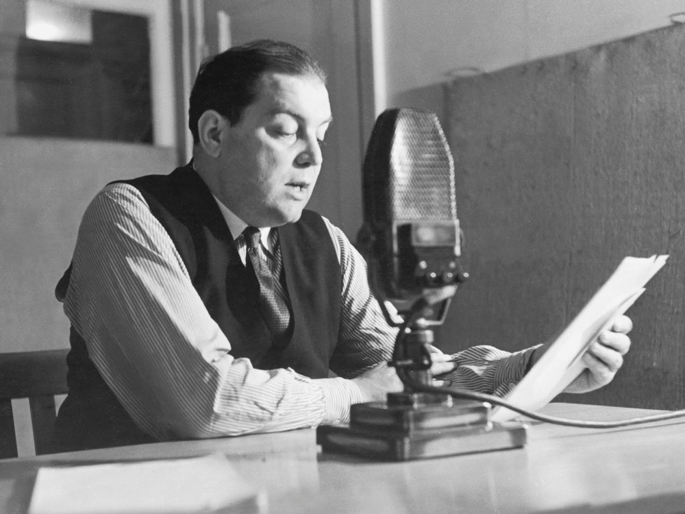 Sefton Delmer reads in the radio booth in 1941.