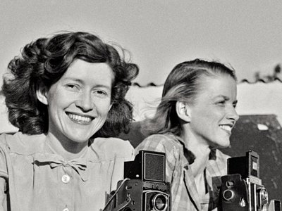 Constance Stuart Larrabee (left) and friend photographing among Ndebele women, near Pretoria, South Africa, 1936.   All photos used in this story are courtesy Eliot Elisofon Photographic Archives, National Museum of African Art, Smithsonian Institution.