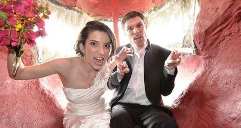 Newlyweds Scott and Amanda Peters inside the mouth of Cabazon Dino Park's Tyrannosaurus