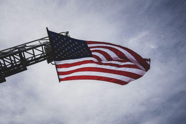 US Flag on Fire Engine Ladder thumbnail