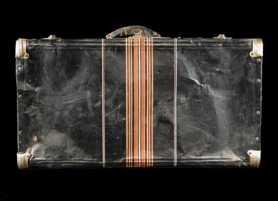 This black metal suitcase belonged to Iku Tsuchiya. It went with her to Tanforan Assembly Center, then to the Topaz camp, and back home to San Leandro, California. (NMAH)