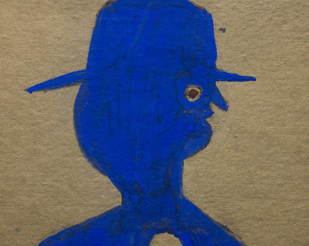 A detail of a painting of a man in blue.