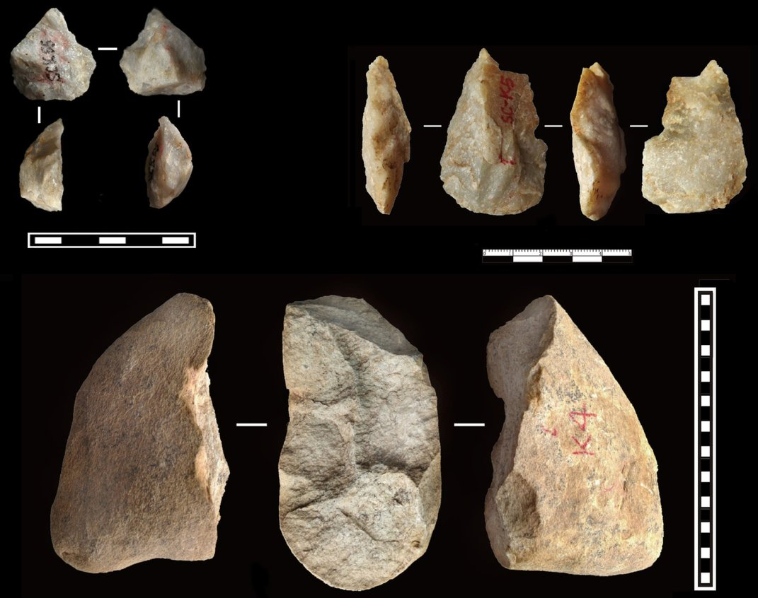 Pieces of a brown rock fashioned into early human tools.