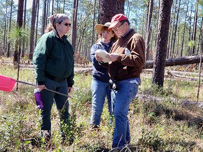 Archeologist Rhonda Kimbrough (left) discusses the survey strategy at Prospect Bluff with author and historian Dale Cox and SEAF Treasurer Janet Bard