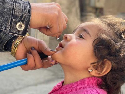 In February, the Covid-19 pandemic halted polio immunization campaigns across Afghanistan and Pakistan, fueling a new resurgence of polio in children. Here, a young girl is given the polio vaccine in the Kabul Province in October after campaigns were resumed.