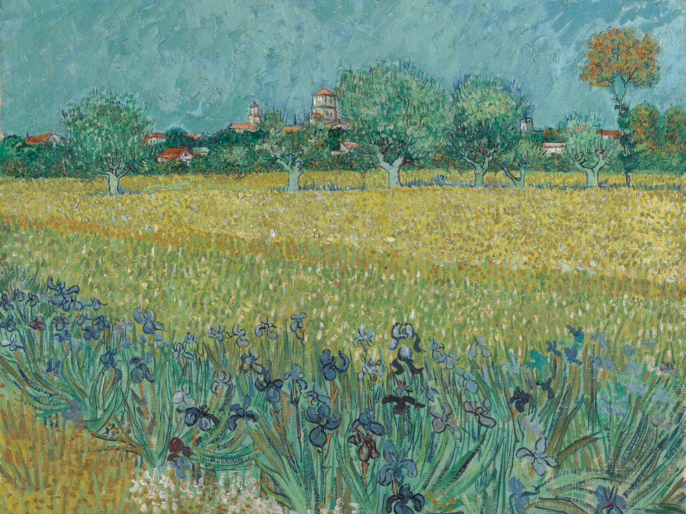 A painting of deep blue irises and a yellowish field, with a muted blue sky and trees behind
