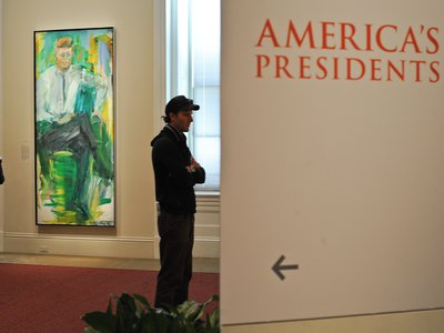 """In an explosion of green and gold, Elaine de Kooning's portrayal of President John F. Kennedy holds pride of place at the National Portrait Gallery in its exhibition """"America's Presidents."""""""