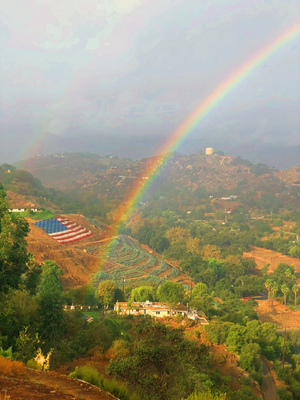 Double rainbow and flag made of flowers converge on a special day at a precise moment in history thumbnail