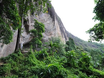 Exterior view of the entrance of Fa-Hien Lena cave in Sri Lanka, where archaeological evidence suggests humans lived about 45,000 years ago.