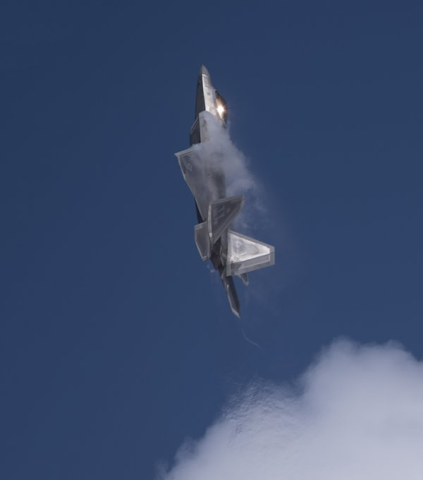 Amidst the Sun and the Clouds An F22 Raptor thumbnail