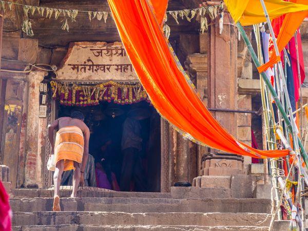 A worshiper climbs the steps to a temple in Khajuraho, India thumbnail