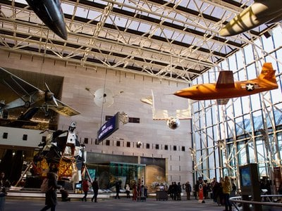 """Visitors can still see iconic aircraft, like the Bell X-1 Glamorous Glennis (right) and Charles Lindbergh's Spirit of St. Louis in the centralized """"Boeing Milestones of Flight Hall."""""""