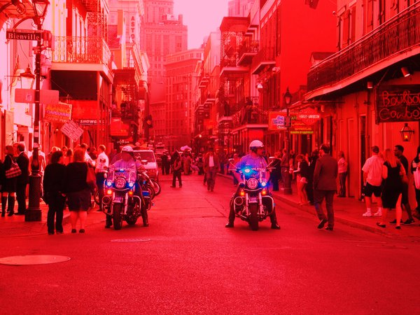 Crimson Bourbon Street with blue lights flashing thumbnail