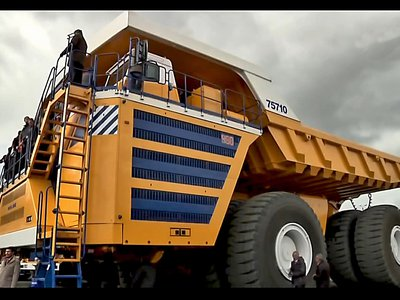 The BelAZ 75710 is the world's largest dump truck —note people in the bottom right for scale.