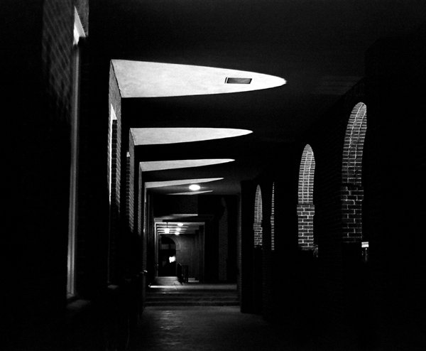An interestingly lit walkway creating unique shadows and shapes. thumbnail