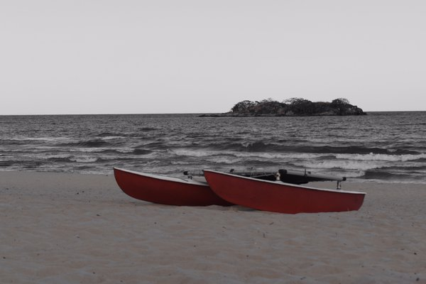 Two Boats sit on the shore of Lake Malawi  thumbnail