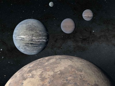 An artist's rendering of the five-planet system that orbits star HD 108236, or TOI-1233. In the foreground is a hot, rocky planet that resembles Earth.