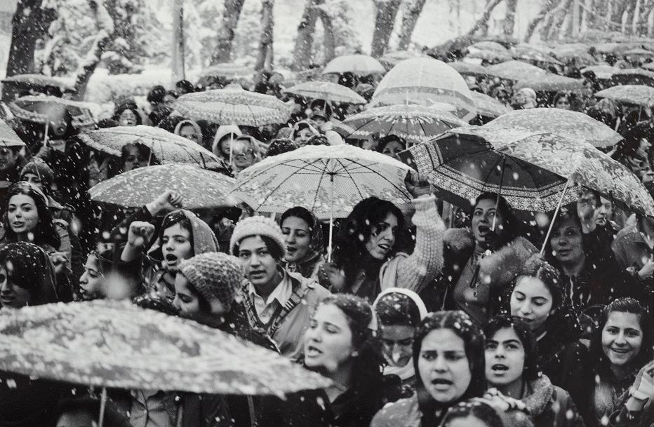 Protestors under umbrellas in the snow