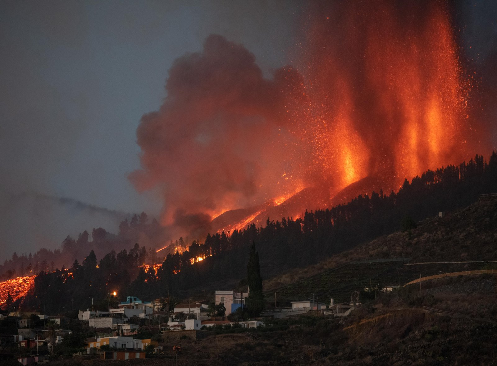 ...Eruption sends lava flowing to residential buildings