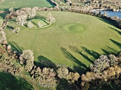 The main circular earthwork at Navan Fort in Northern Ireland measures roughly 130 feet in diameter. But archaeologists surveying the site have found signs of even larger structures that may have been temples.