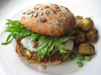A veggie burger with a zucchini, feta, and pea patty.