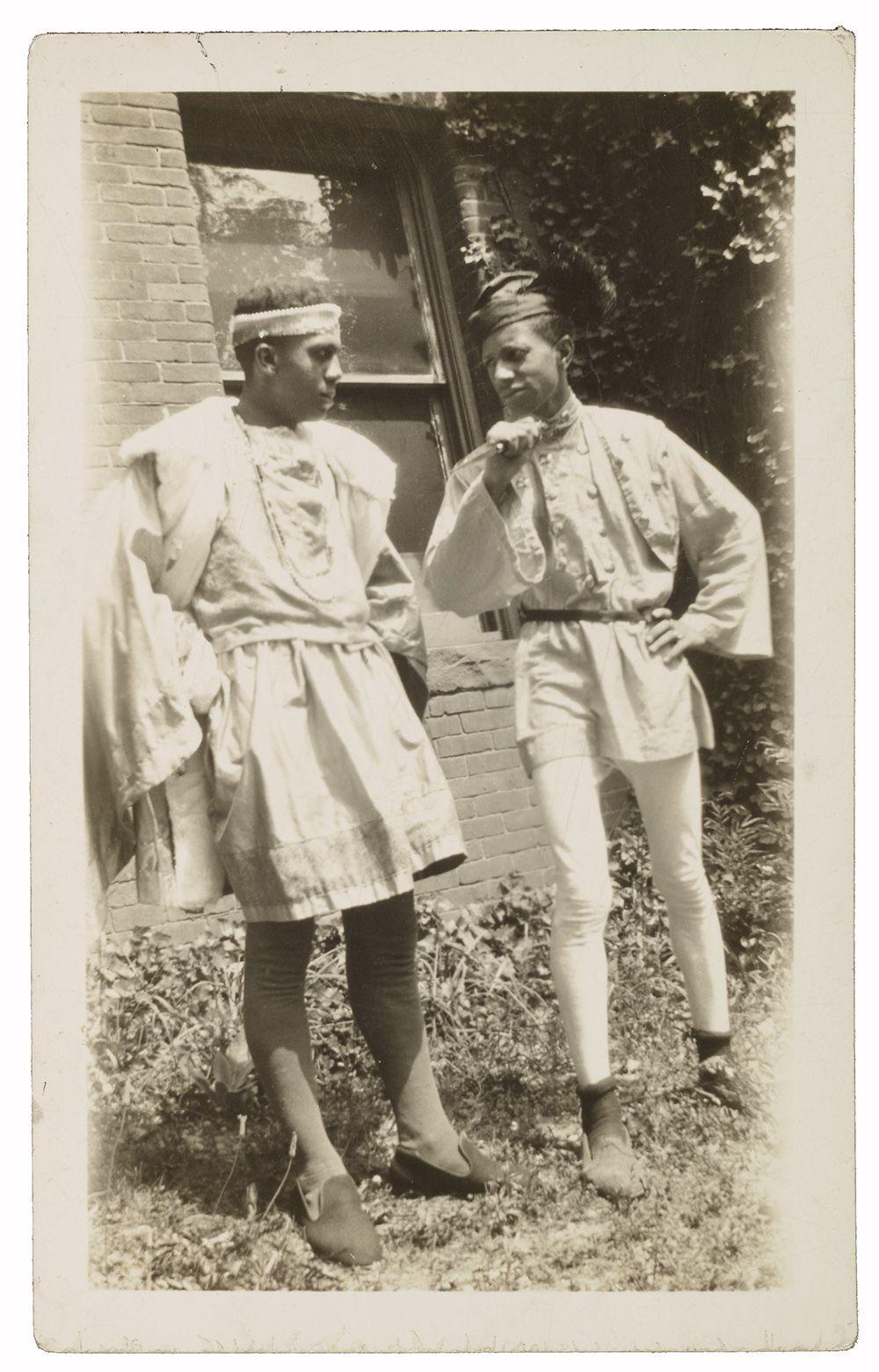Two Howard University students wearing Renaissance-style costumes designed by Alma Thomas.