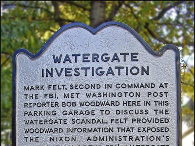 """A plaque outside of the Rosslyn, VA garage where the informant code-named """"Deep Throat"""" met with journalist Bob Woodward during the Watergate investigation."""