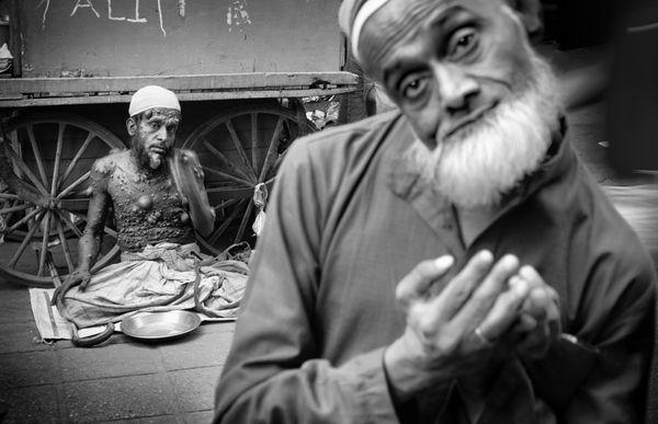 A leprous man and a beggar. Nizamuddin West, Delhi, 2018. thumbnail
