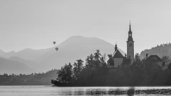 Two Hot Air Balloons at sunrise over Lake Bled thumbnail