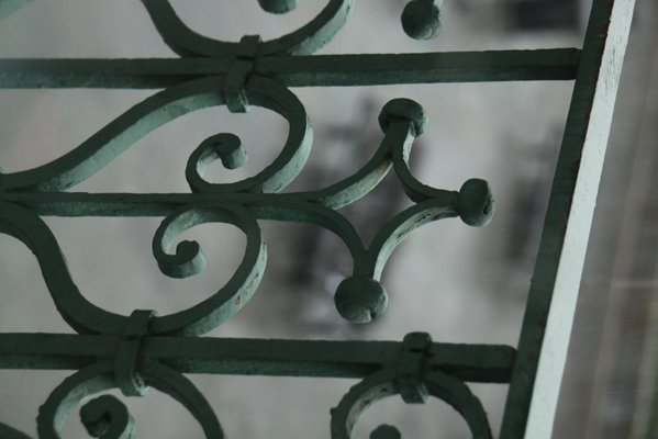 Wrought iron detail overlooking Jackson Square during a storm. thumbnail