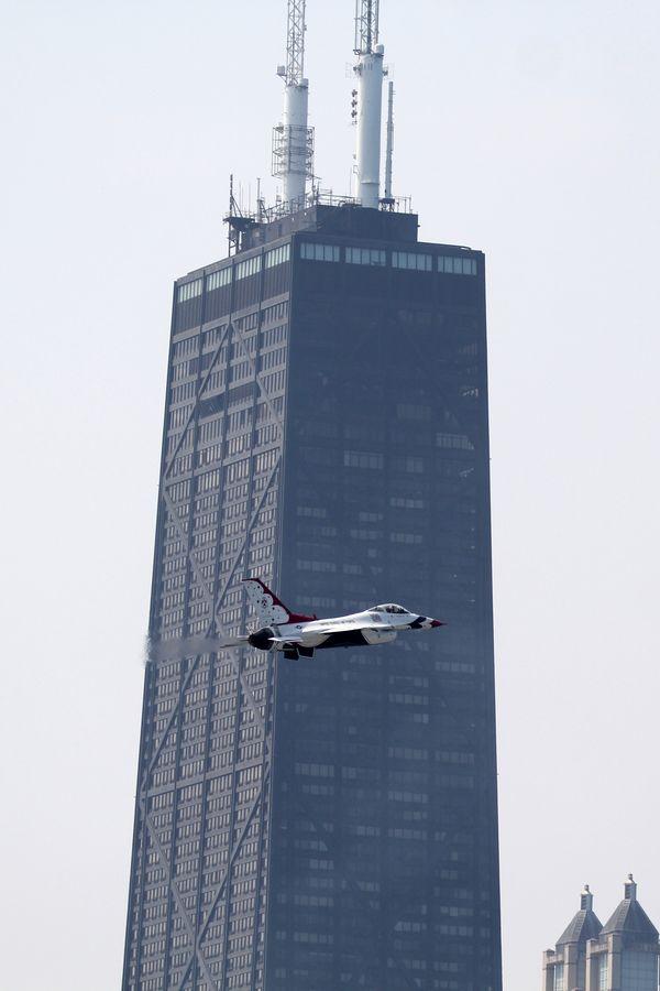 USAF Thunderbird flying near John Hancock Building thumbnail