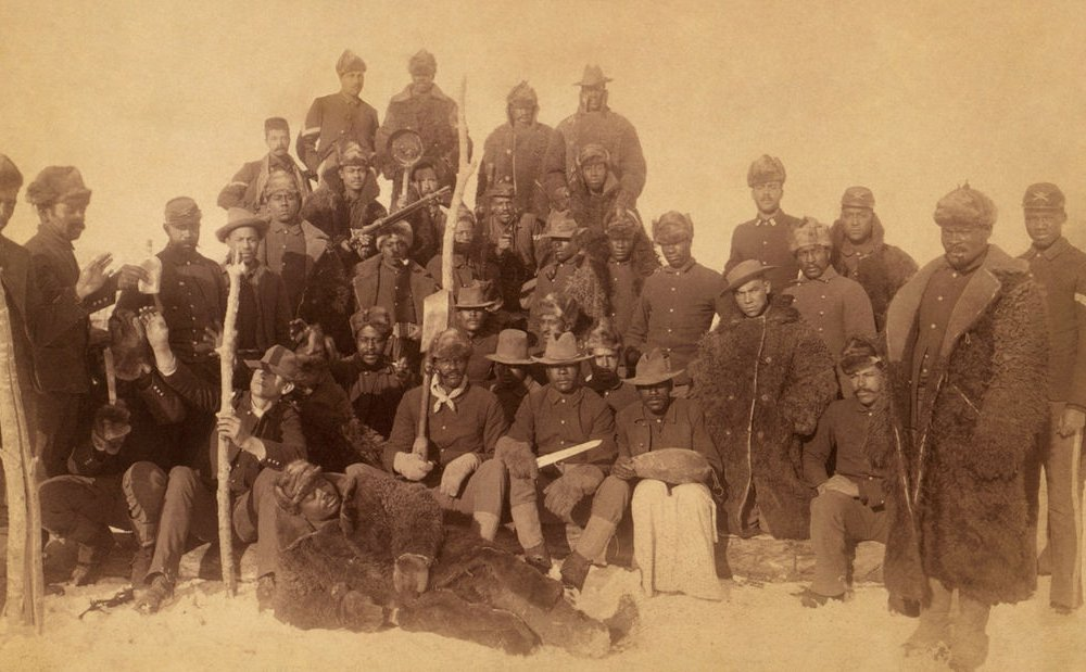Buffalo soldiers of the 25th Infantry, some wearing buffalo robes, Ft. Keogh, Montana