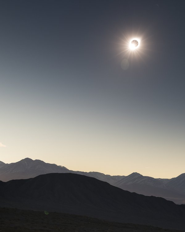 Total solar eclipse above the peaks of the Andes thumbnail