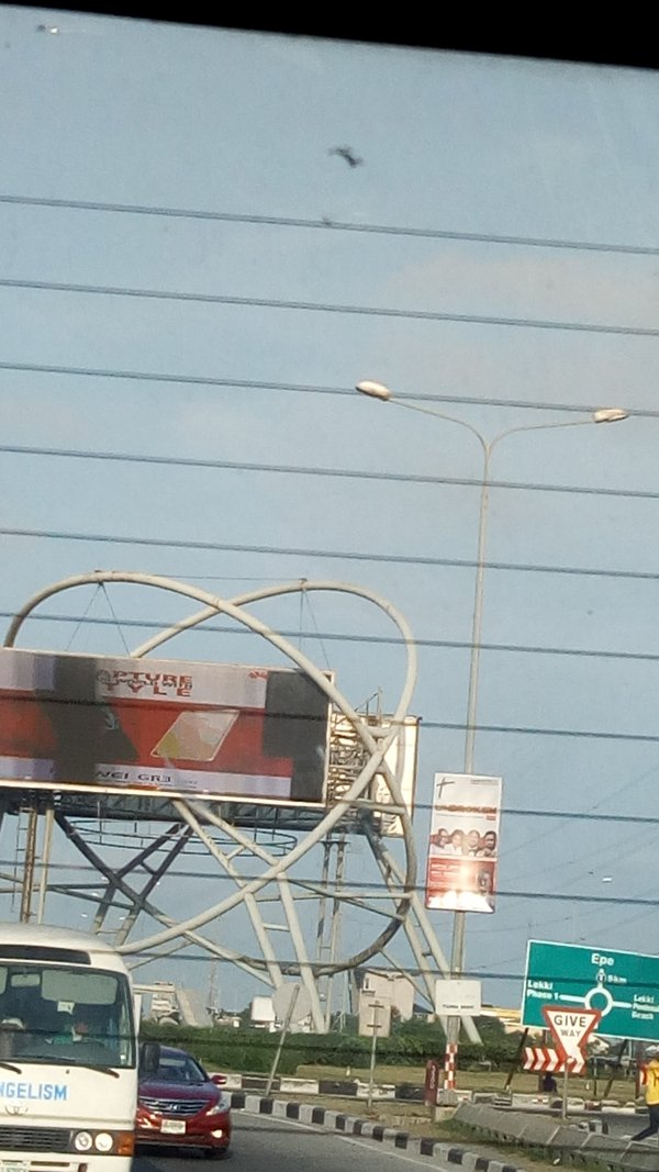 An encircled electric billboard at the center of a road after Lekki toll gate.  thumbnail